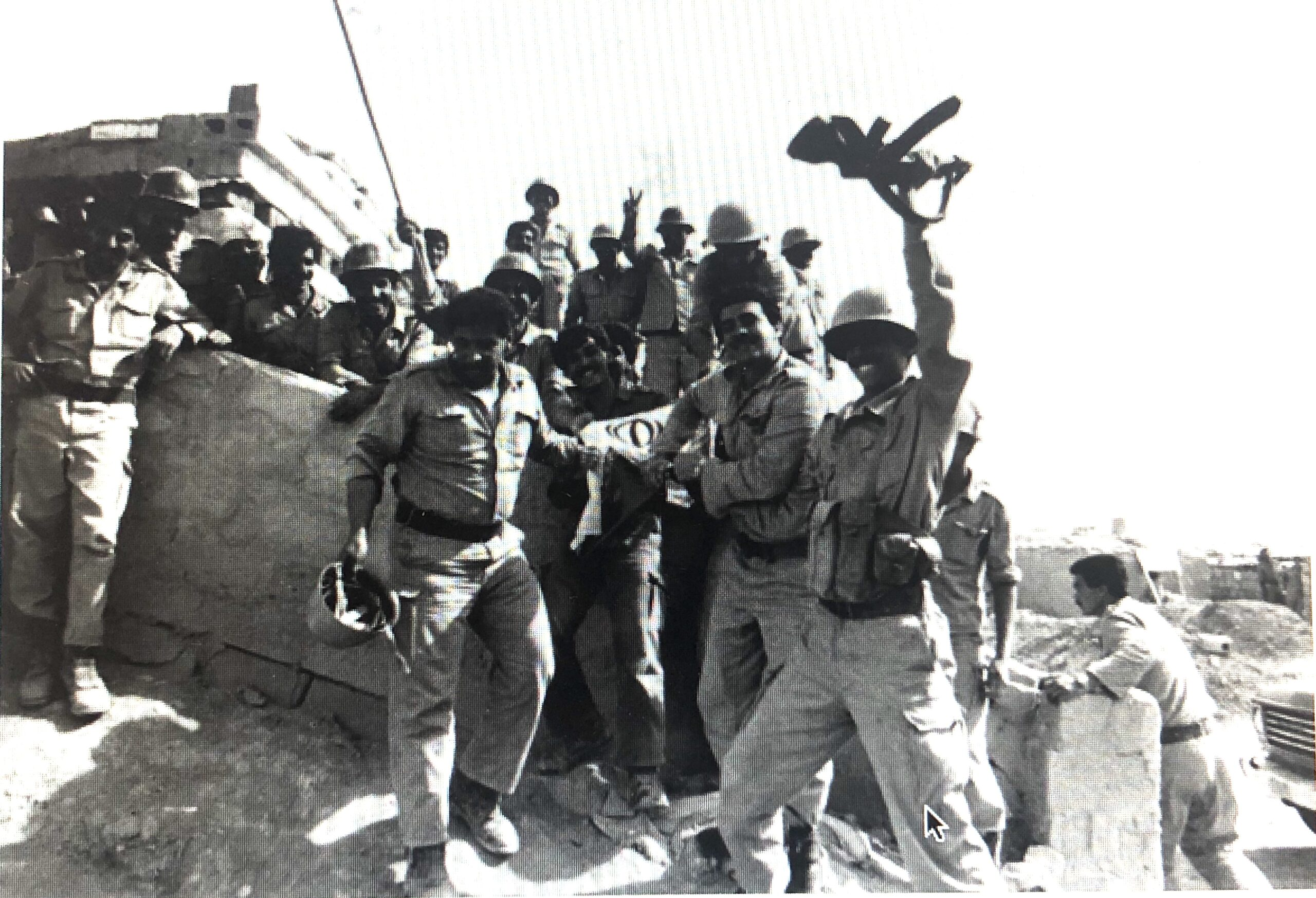 Iraqi soldiers celebrate after capturing Iranian cities